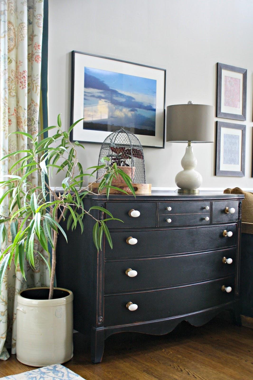 white knobs black dresser