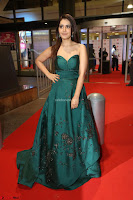 Raashi Khanna in Dark Green Sleeveless Strapless Deep neck Gown at 64th Jio Filmfare Awards South ~  Exclusive 156.JPG