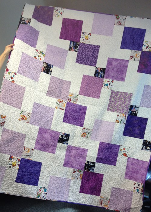 Disappearing 9-Patch Quilt with Layer Cakes designed by Jen Eskridge of Reanna Lily Designs