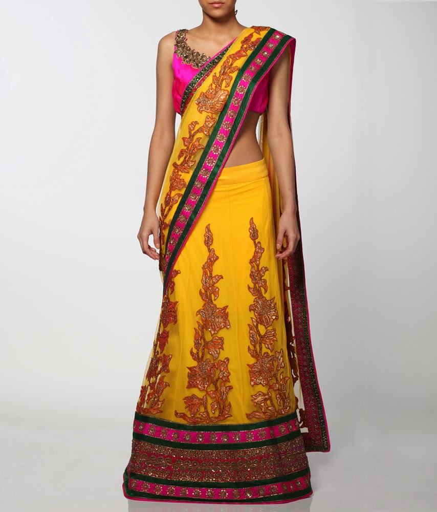895700e0348a A lovely sunshine yellow net saree lehenga embellished with kanjivaram  appliqué and a wide pink and green hand embroidered border with sequin work.