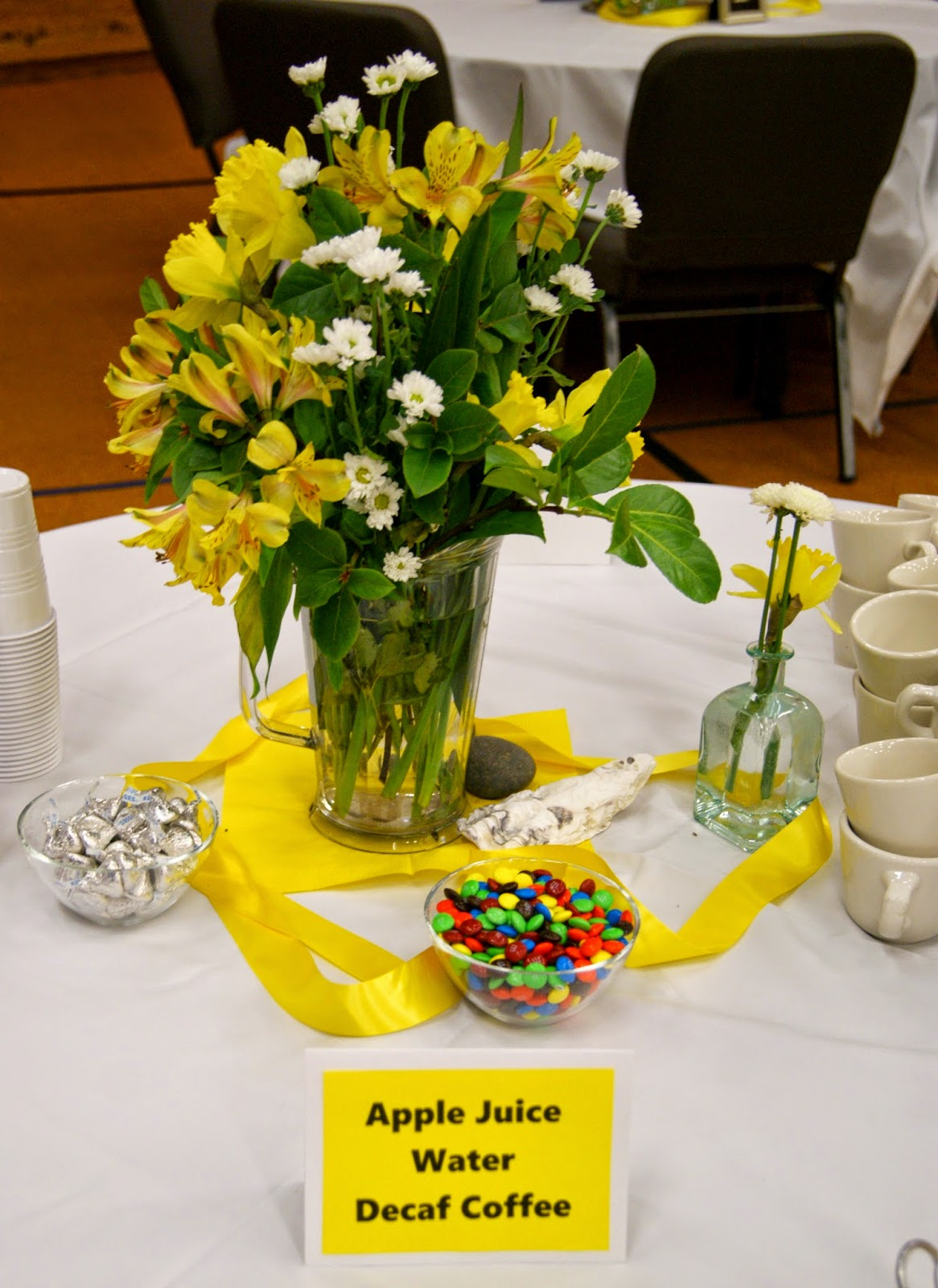 Some Tables Had The Easter Lilies On Them Others Yellow And White Flower Arrangements