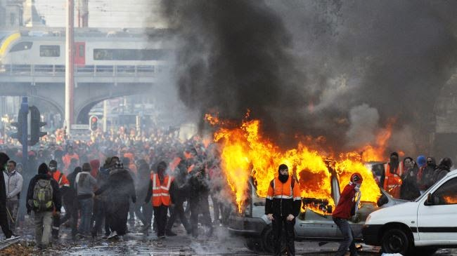 Clashes have broken out between police and people protesting against the new Belgian government's austerity