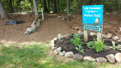entrance to Parmenter Nature Trail (bird house now in its own circle of stones to the left of the trail)
