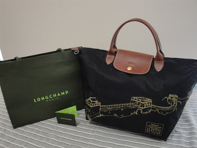 The special Asian edition of LONGCHAMP - GREAT WALL OF CHINA. Medium size  with short handle. Stunning gold colour printing on the black nylon. b30763dbaaa03