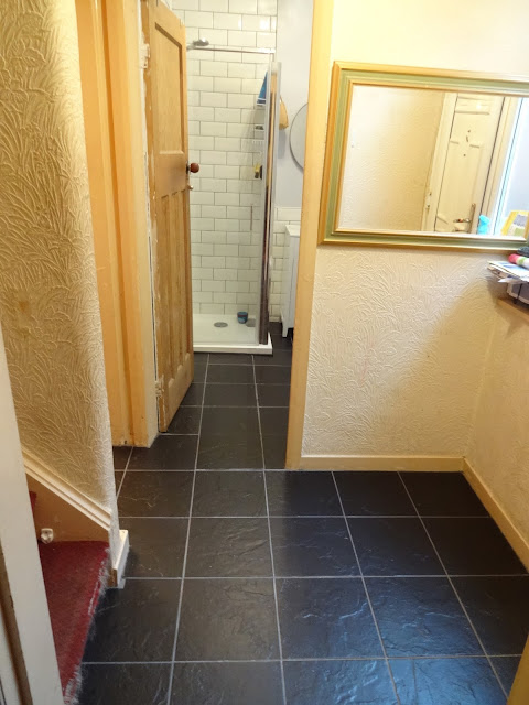 Black Tiled Hallway