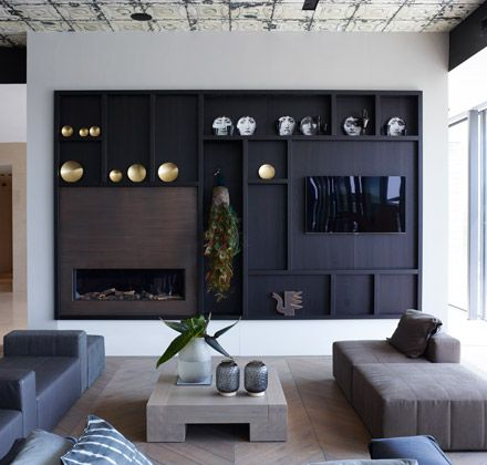 Modern luxury media wall fireplace minimal sophisticated interior design by Piet Boon