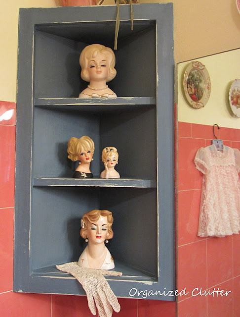 Head vases in a vintage bathroom