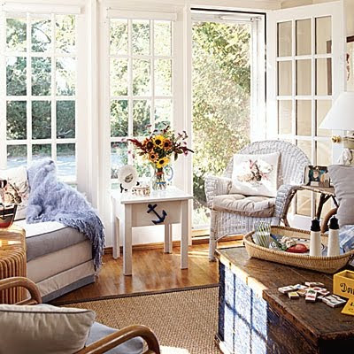 white wicker accent chair in a sunroom