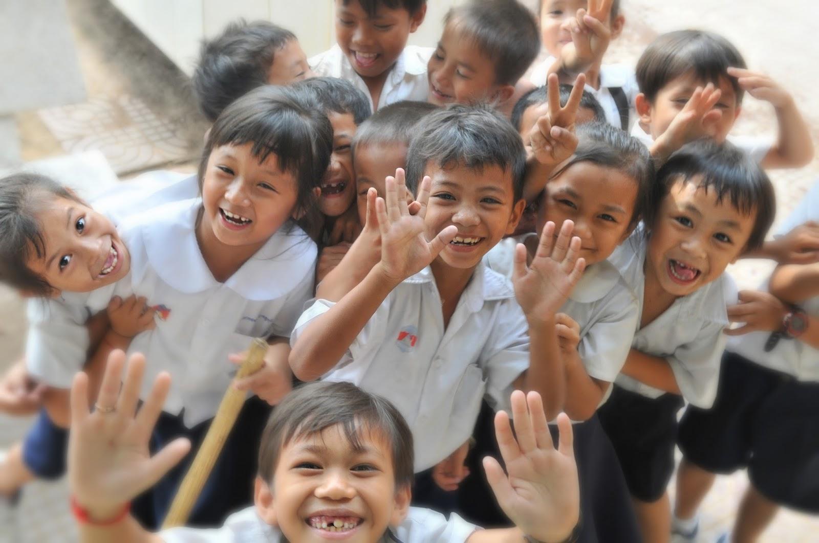 NAMC Montessori normalization elementary teacher laughing school children