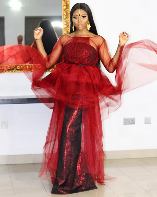 Stephanie Coker wows in red Arabian inspired outfit
