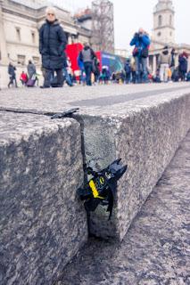 Batman Climbing Down A Curb
