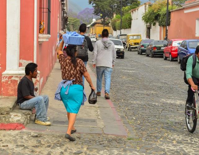 Locals walking through the cobblestone streets of Antigua