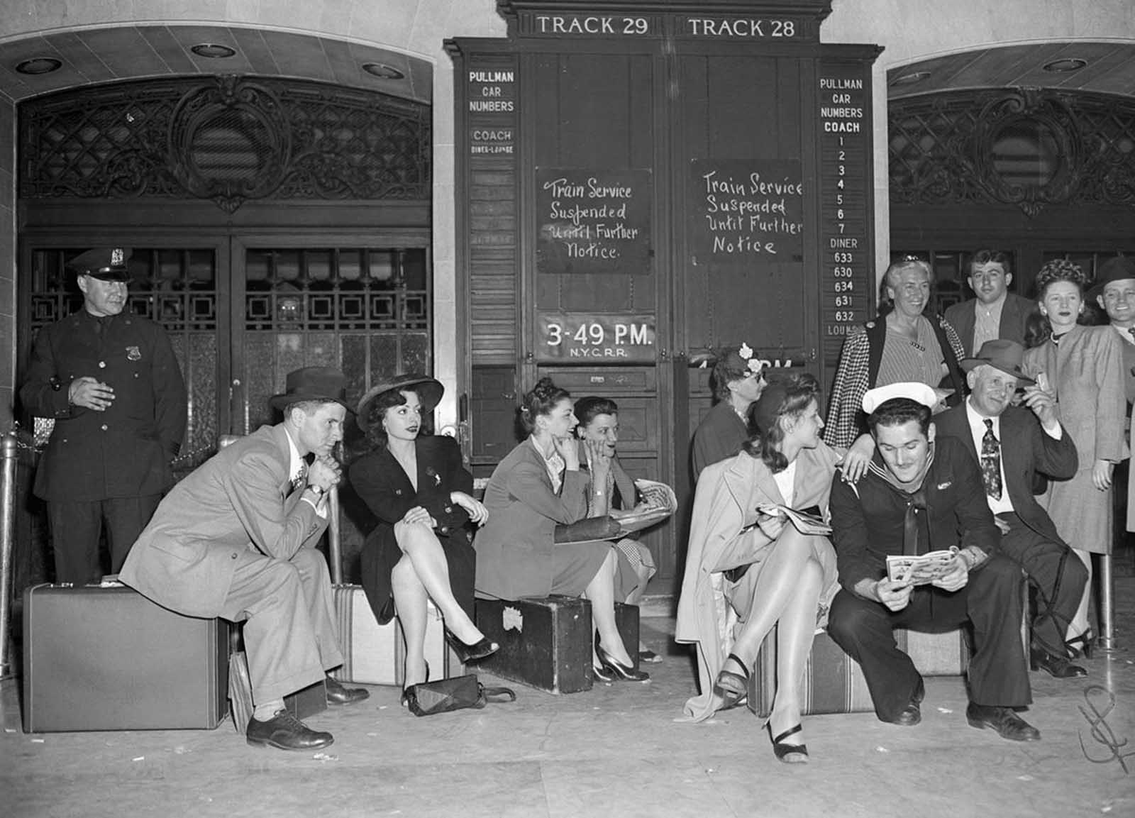 Would-be passengers sit on their luggage in Grand Central Terminal on May 23, 1946, where they were stranded by a rail strike.