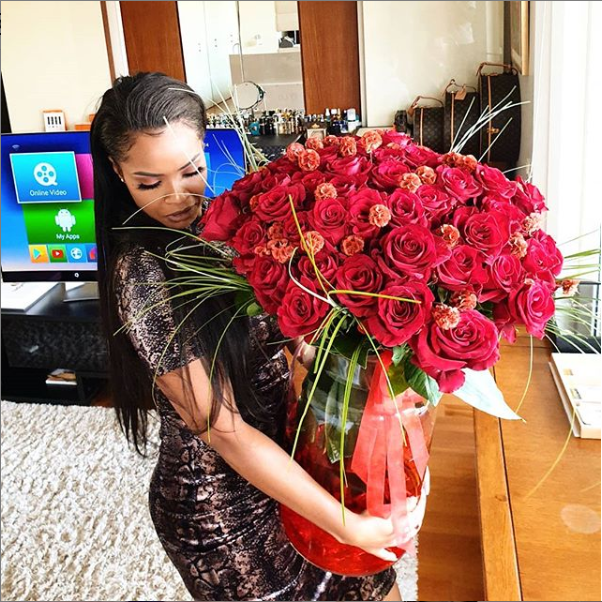 Emmanuel Adebayor Surprises Girlfriend Dillish Mathews with Giant Bouquet of Red Roses on Val's Day