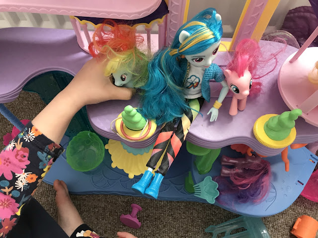 Rainbow Dash Equestrian girl doll in toy castle with ponies being played with