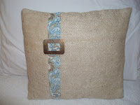beige pillow with vintage buckle