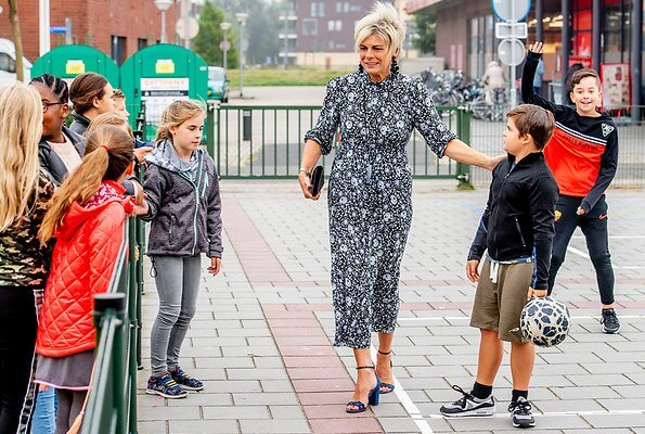Princess Laurentien attended the launch of a new national education programme at primary school Het Avontuur in Almere. floral print silk dress