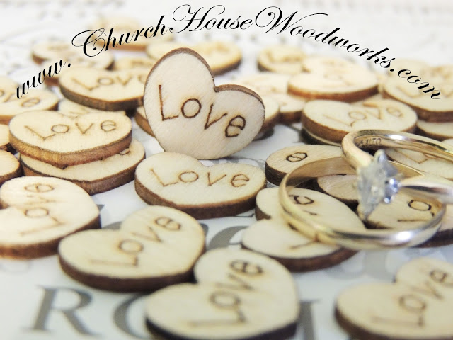 Wood Burned hearts with the word love on it. Confetti. Rustic weddings, barn weddings, centerpieces, decorations, table decor