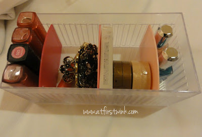 Daiso plastic storage case with pink dividers