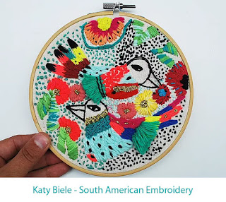 embroidery hoop with colourful birds, leaves and flowers densely stitched with thick threads in a naive style