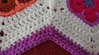 African flower hexagon baby blanket. Dips