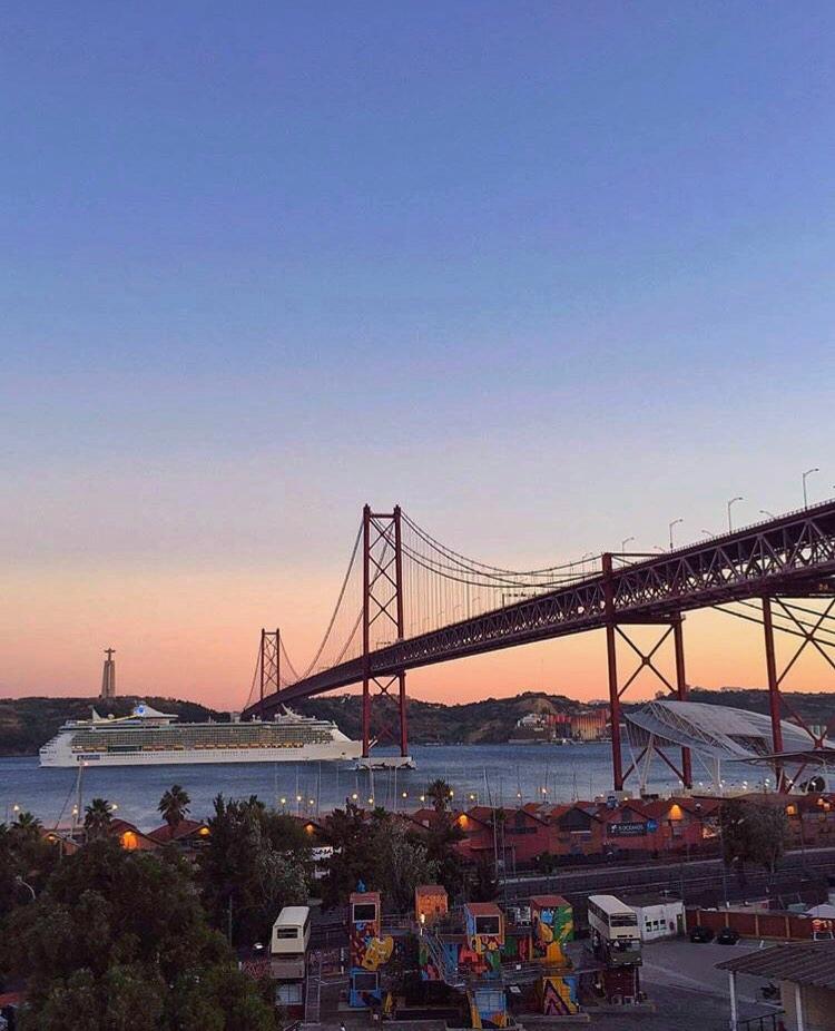 sunset over 25 de Abril Bridge from Lisbon's LX Factory
