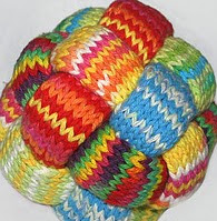 http://www.ravelry.com/patterns/library/gevlochten-bal---braided-ball