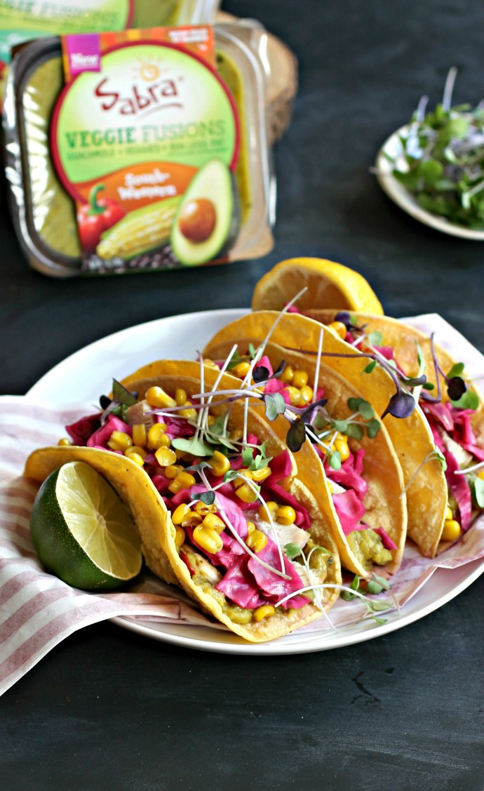 Recipe for tacos made with cumin grilled chicken, guacamole and pickled cabbage.
