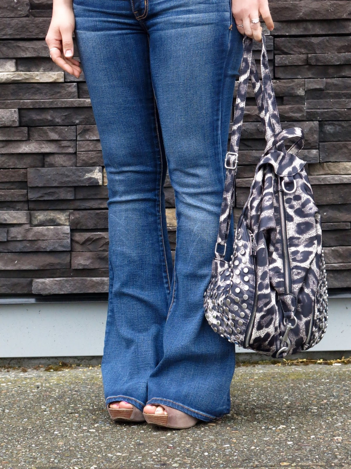 flare jeans, leopard-print backpack