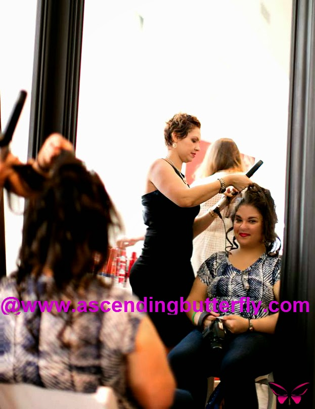 Stylists from Angelo David Salon offer hair touch ups at Getting Gorgeous 2014