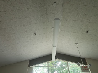 New light fixtures on the high ceiling of Little Falls Library