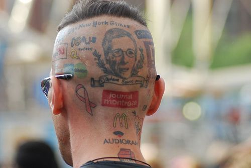 Corporate logo tattoos on his head