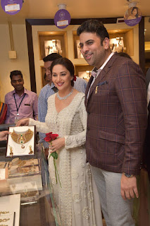 Actress Madhuri Dixit Pictures in Designer White Salwar Kameez at PNG Jewelers Launch  0003