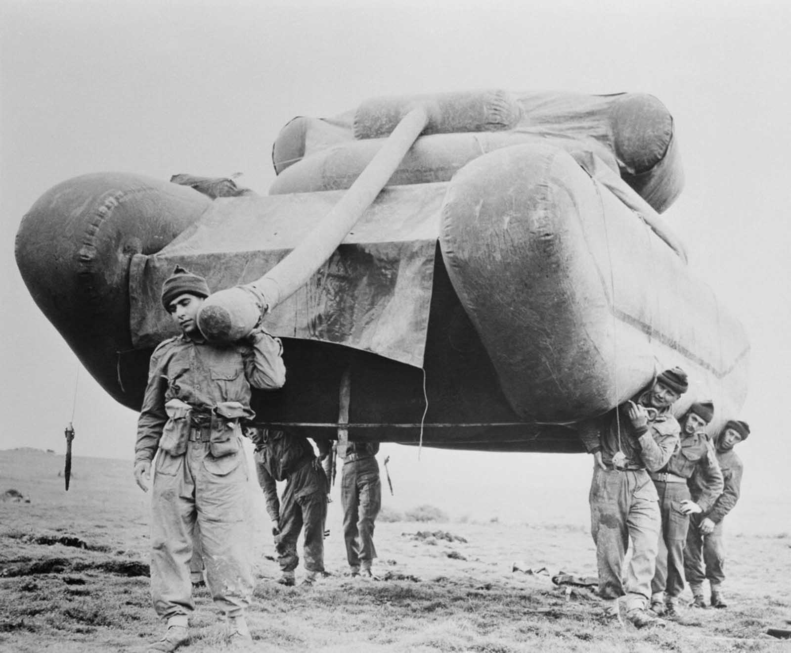 British soldiers hoist an inflatable dummy tank during exercises on Salisbury Plain (after the war ended).