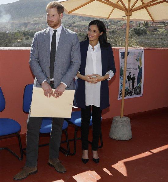 Meghan Markle wore Alice + Olivia Simpson blazer, Birdies blackbird smoking slippers, Boh Runga gold studs