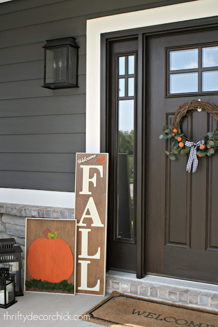 Using stain for DIY fall signs on front porch