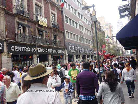 Crowds at the pedestrian street Mexico City on way to Festival of the Dead' - by K J S Chatrath