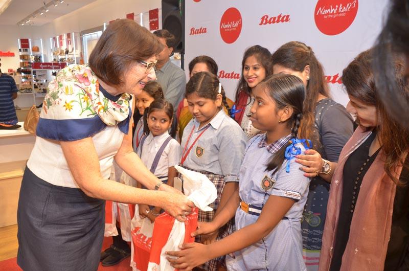 Christine Schmidt, Director, Bata Shoe Organization presenting shoes to girls under Nanhi Kali initiative