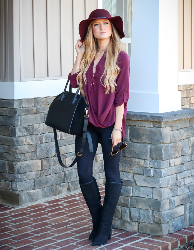 floppy hat burgundy tunic black leggings