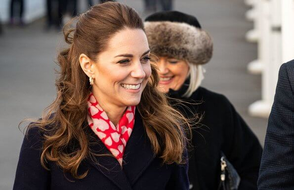 Kate Middleton wore a new navy coat by Hobbs London, and a new knitted puff-sleeve midi dress by Zara. Beulah London Kamala scarf