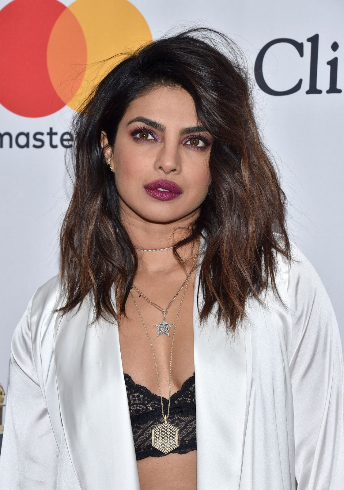 Priyanka Chopra flashes lace bralet at the 2018 Clive Davis Pre-Grammy Gala