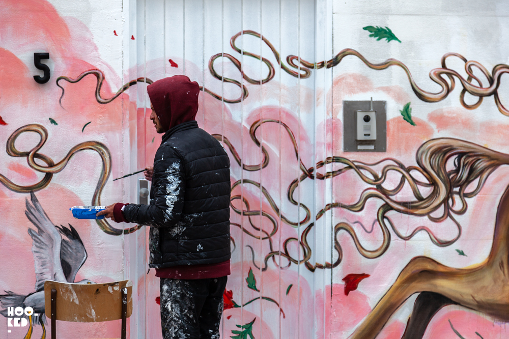 Artist Mateus Bailon at work painting a Mural in Ostend