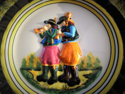 HB HENRIOT Quimper Glazed Art Pottery Plate, very Rare Black and Yellow Barbotine Biniou and Bombarde Musicians motif. Signed underside.