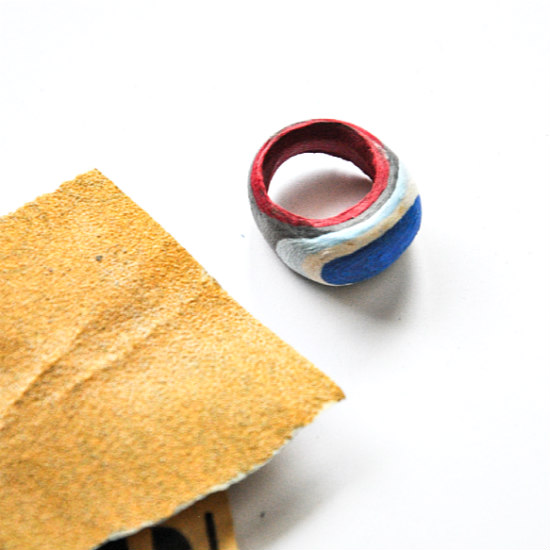 sandpaper with layered paper ring in progress