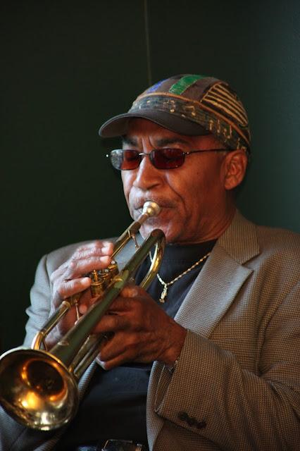 ... Tarika Lewis, violin, Earl Davis, trumpet, <b>Tacuma</b> <b>King</b>, percussion