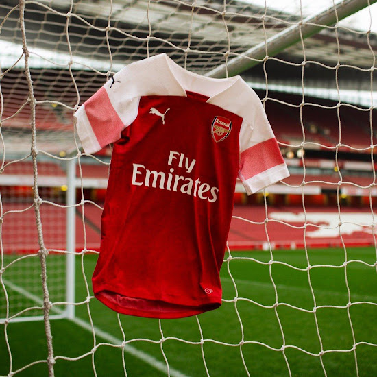 The Logos On The Front Of The New Arsenal Home Shirt Are White While The Puma Cat Logos On The Sleeves Are Navy