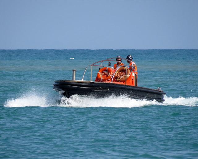 """A service boat of the """"ormeggiatori"""" (mooring crew), port of Livorno"""
