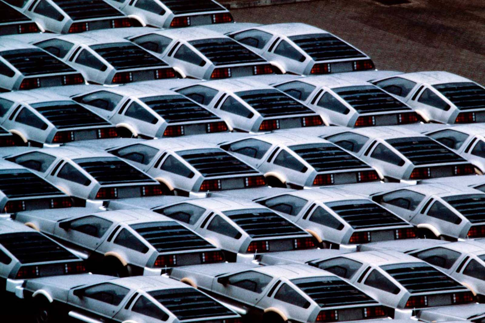 Stockpiled Delorean cars at the Delorean Motor plant, Northern Ireland. 1982.