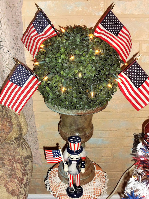 i strung some lights around it placed it in the urn and tucked a few mini flags in it - Is Wegmans Open On Christmas