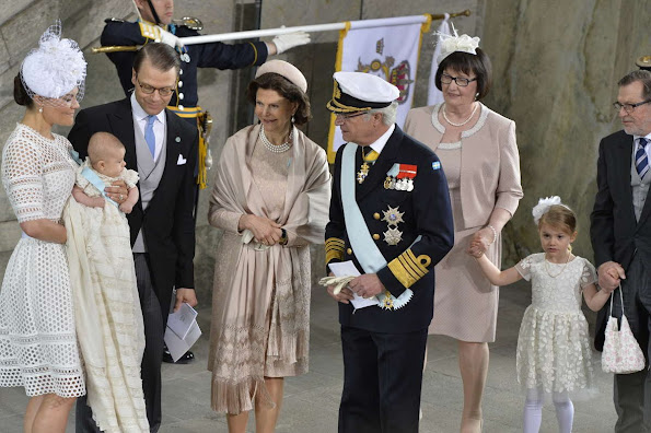 Queen Silvia and King Carl Gustaf of Sweden, Crown Princess Victoria, Prince Daniel, Princess Estelle, Princess Madeleine of Sweden with daughter Princess Leonore and Christopher O'Neill, Prince Carl Philip and Princess Sofia, Prince Haakon and Princess Mette-Marit of Norway, Crown princess Mary and Prince Frederik of Denmark, Ewa and Olle Westling at the christening of Prince Oscar of Sweden at the Royal Chapel in Stockholm.Antonio Berardi Blue Cape-back Stretch Crepe Dress